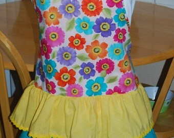 Cute spring apron with cosmos in a variety of bright colors