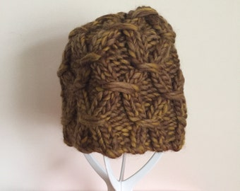 Hand knitted merino wool hat with smocked pattern