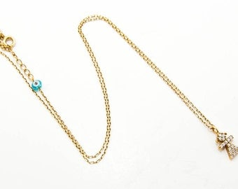Sterling silver-gold plated pendant with zirgon and a blue bead 7039