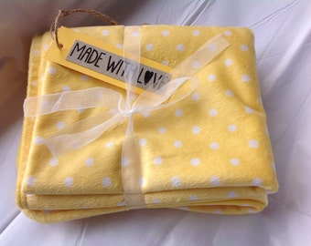 Sunshine yellow spotted baby blanket.
