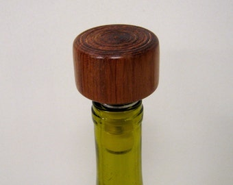 Handmade tulip wood bottle stopper. Beautiful wood grain. Makes the perfect wedding gift. Specialty Turned Designs
