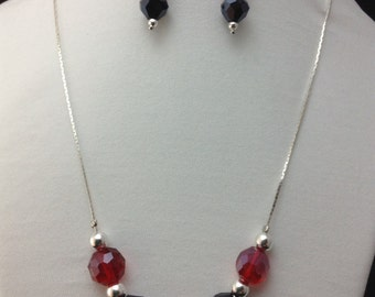 Simple black, red and silver beads on a silver plated chain