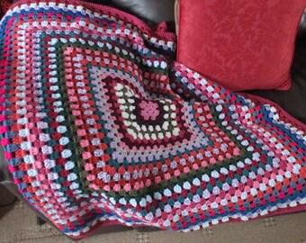 Crocheted granny square lap blanket