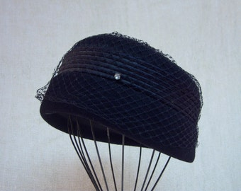 vintage hat,pill box hat,Henry Pollak,black wool,black netting,satin trim,rhinestones,union made tag,size Medium,vintage accessories,formal
