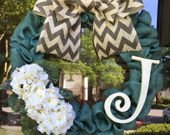 Burlap Wreath - turquoise burlap wreath accented with beige flowers and letter cutout