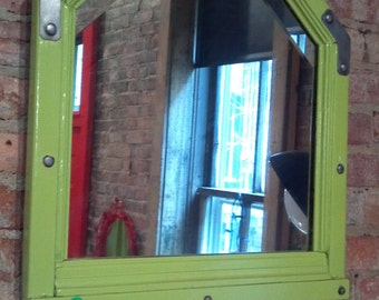 Unusual shaped Vintage bevelled mirror with authentic industrial flair.