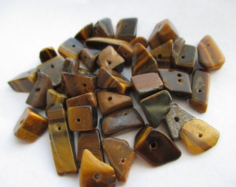 Genuine Tumbled Polished Tigers Eye Drilled Chunks 20pc Bag. Item:BC818480