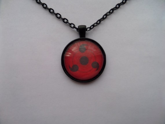 sharingan inspired necklace by theramenempire on etsy