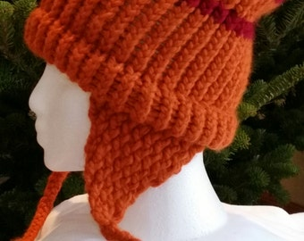 On Sale! Hand knitted hat with ear flaps. This hat  in  burnt orange/cranberry,  is made of  thick acrylic/wool  yarn.