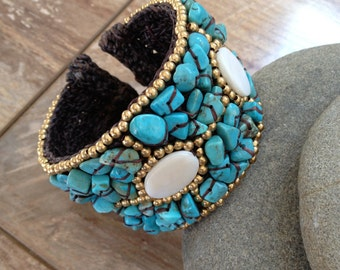 Handmade beaded bracelet with turquoise white and gold beads