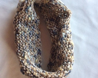 Beige, gray and gold hand knitted cowl.
