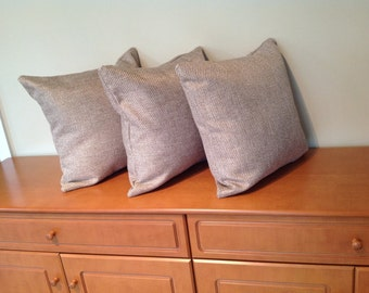Light brown woven fabric cushion
