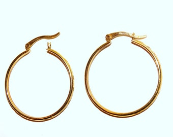 "10k Yellow Gold Hoop Earrings 1.20"" round size, 3 Grams weight"