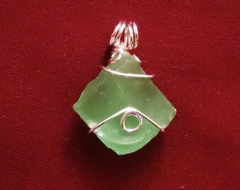 Green buffed glass and silver pendant