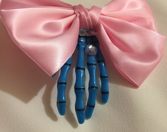Skeleton hand hair accessory with bow