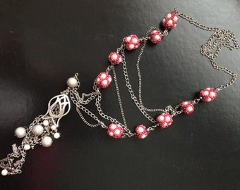 Necklace with chain and bead balls