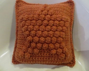 Embossed star crochet cushion in wool
