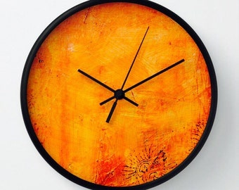 Orange-golden abstract clock, carved of wood and hand painted