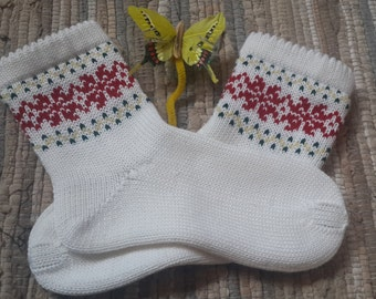 Hand made knitted socks with ornament