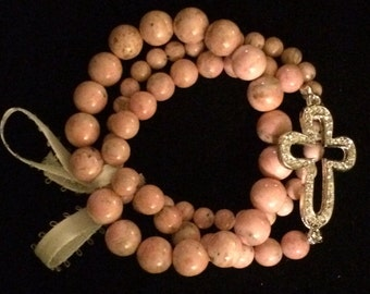 Cross and pearl bracelets