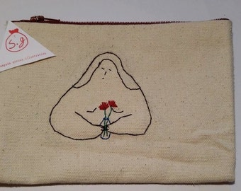 Hand embroidered and hand stiched Illustrated purse.