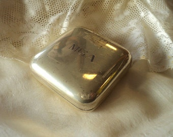 Silver pill box with cypher