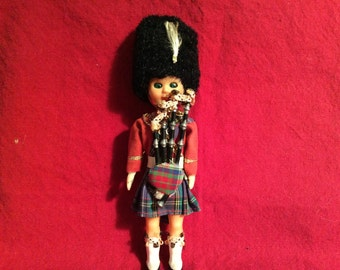 Vintage English bagpiper doll