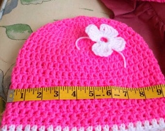 Hot pink beanie with flower