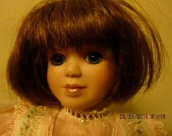 Vintage porcelain collectible doll brunette dressed peach lace white shoes