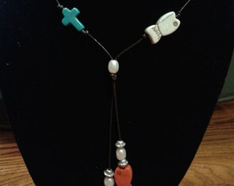 Cross and fish leather necklace
