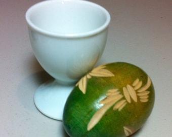 Collectable vintage wood carved Easter egg and porcelain egg cup