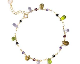 Multi-gemstone bracelet in 14k GF. Garnet, Peridot, Moonstone, Amethyst, Pearl, Spinel. Single Strand
