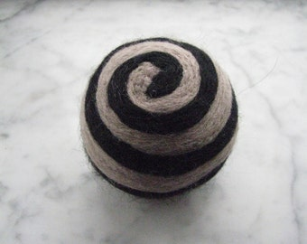 One multi-colored felted pin-cushion, Gray and Black