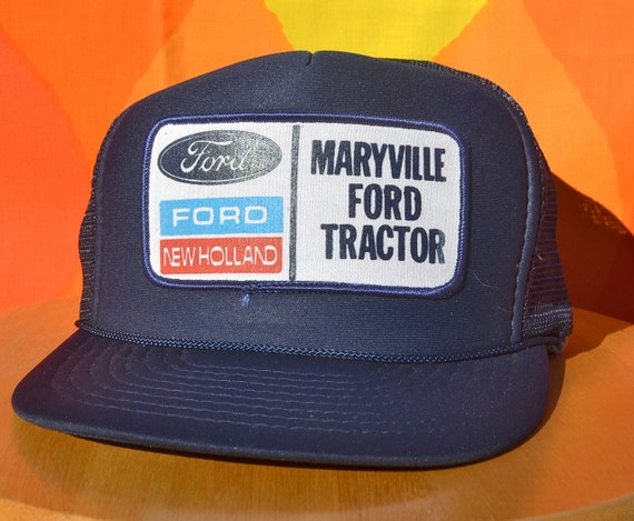 https://www.etsy.com/listing/210533875/80s-vintage-foam-trucker-mesh-hat-ford?ref=shop_home_active_18