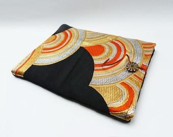 Orange, gold, silver and black vintage scallop design obi fabric iPad sleeve