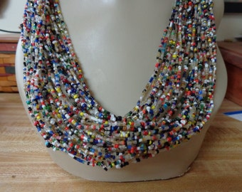 Pretty seed bead necklace made with 15 strands of colorful seed beads