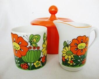 2 vintage mod flower cups and pitcher yellow orange ceramic set