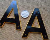 a - vintage plastic marquis letter found objects for altered art and craft projects