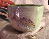 Serene  cafe au lait cup with fish and pretty patterns
