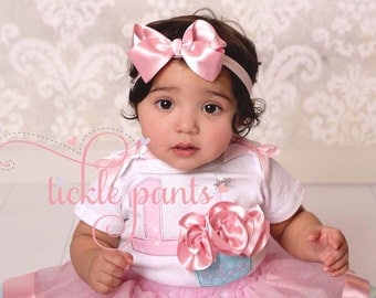 Please make a hairbow to match my sweet baby's birthday tutu!