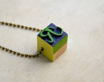 Vintage wooden typographic necklace. Antique bronze chain. Letter R green yellow blue wood