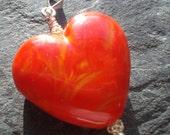 fiery orange red heart lampwork pendant