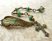 Beaded wing bracelet, brass wing with verdigris patina and Czech glass beads