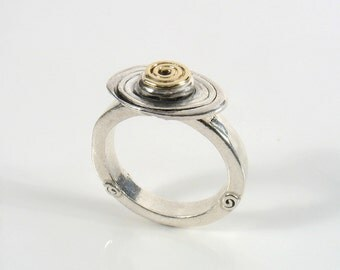 Gold spiral set on a Sterling silver spiral that also is soldered on a larger spiral.Eternal ring,statement spiral two tone ring.