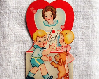 vintage Valentine's Day card, boy and girl mailing cards to teacher