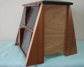 Handmade jewelry box made from reclaimed, exotic woods.