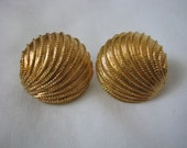 Round gold tone shell clip on clip back earrings by Napier