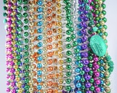 Multiple strands Mardi Gras beads / plastic beads / gold blue orange purple green pink / stars dice Rio casino / gambling / party / fun