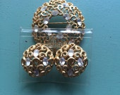 Trifari Gold and Jeweled pin and clip earrings set.