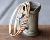 Slender gold hammered bangles- the 5 stack